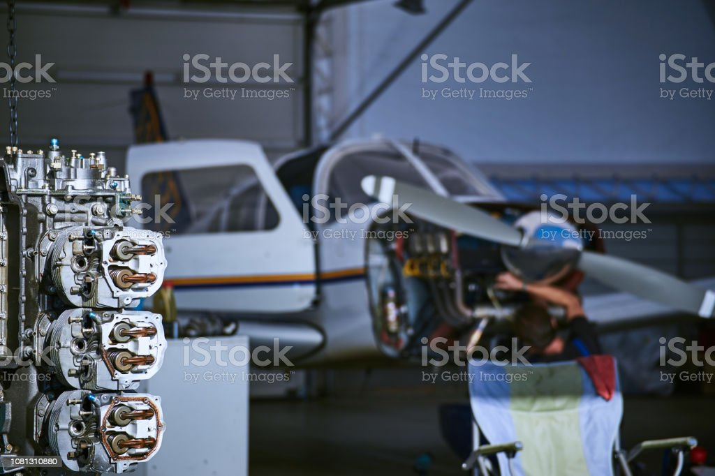 Removal and repair of an airplane engine by a service worker. stock photo