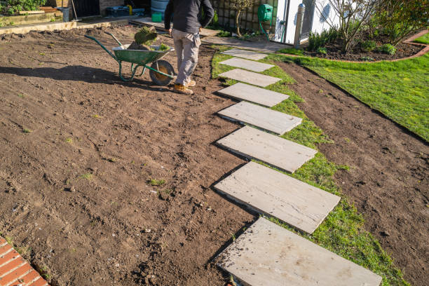 Removal of old turf around a new stepping stone walkway in preperation for the installation of a new turf lawn. stock photo