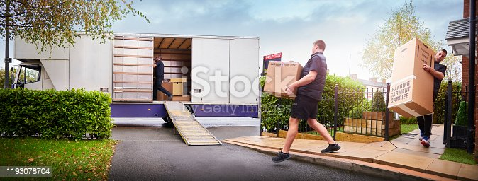 Removal company helping a family move out of their old home
