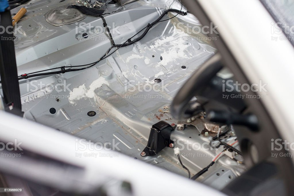 Remove car seat for clean dust trap carpet in car stock photo
