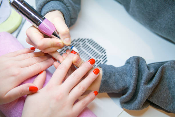 Remove Old Nail Polish, manicure. Milling of nails. Removing the nail plate with a milling machine. – zdjęcie