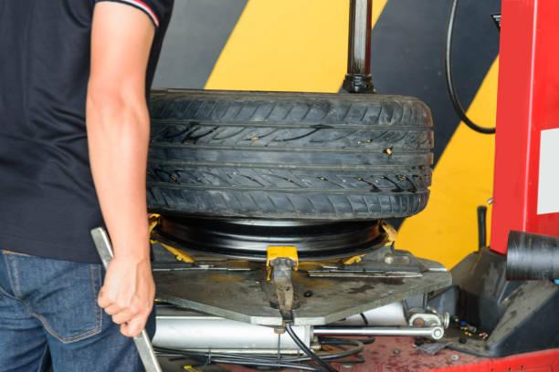 Remove the rubber wheel machine/ Tire changer machine stock photo