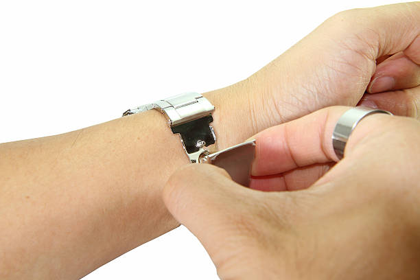 remove the watch from wrist stock photo