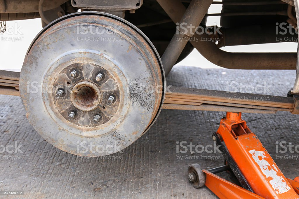 remove wheel by car jack for repair. selective focus wheel stock photo