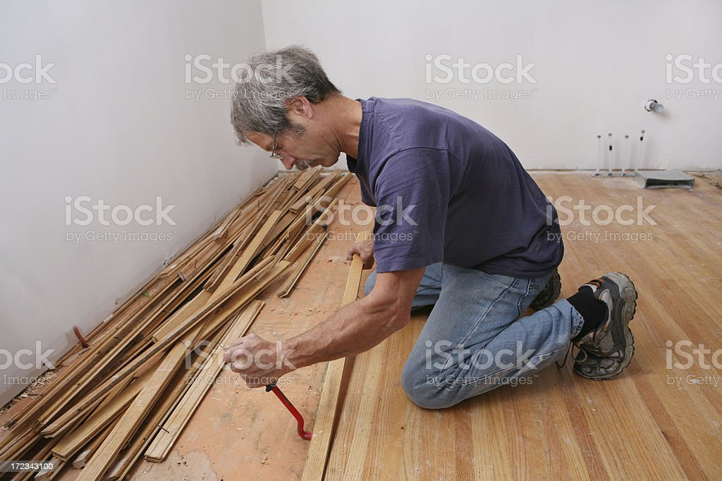 Removing and Recycling Oak Floor royalty-free stock photo