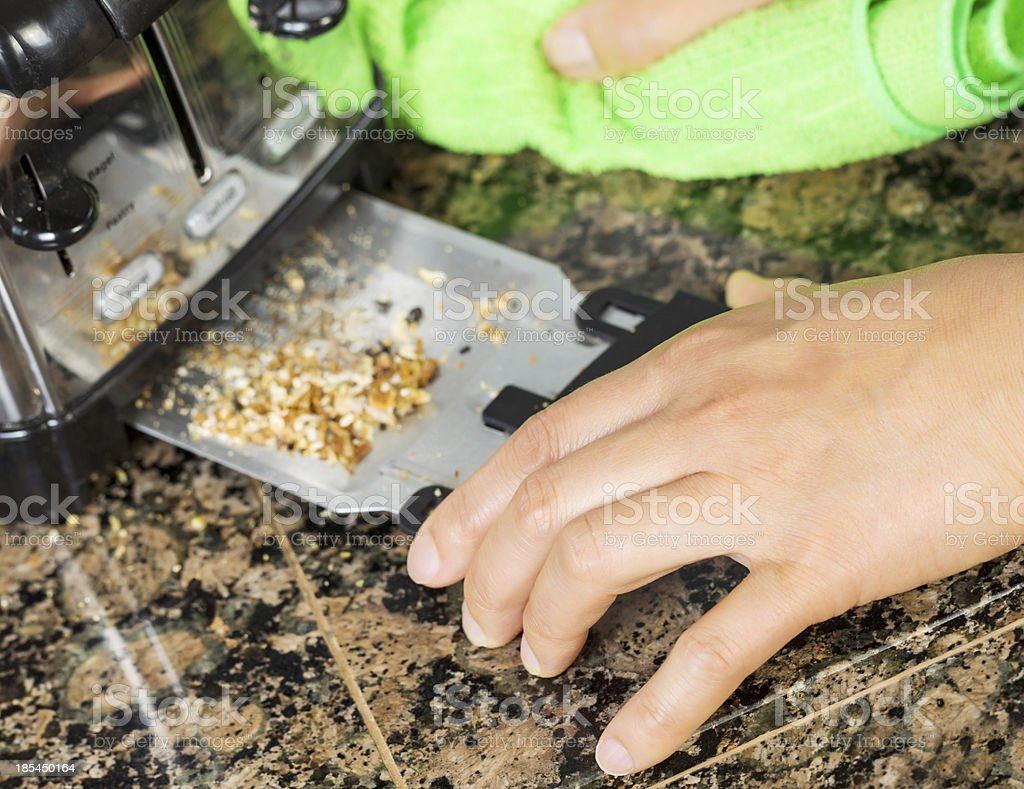 Removing bread crumbs from Kitchen Tray Toaster stock photo