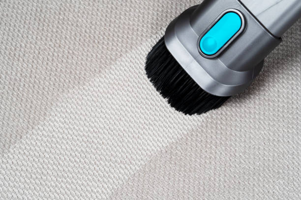 Removing dirt from sofa with upholstery cleaner. Sofa chemical cleaning. Upholstered furniture cleaning. Process of deep furniture cleaning. Dry cleaning. Before and after. Washing concept. stock photo