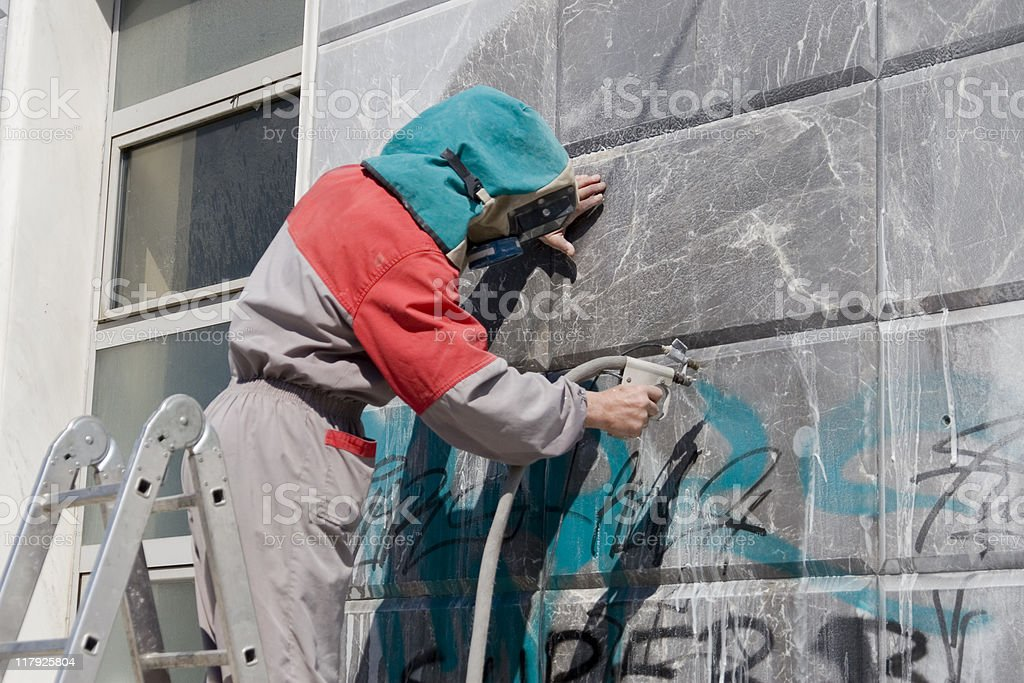 Removing graffiti royalty-free stock photo