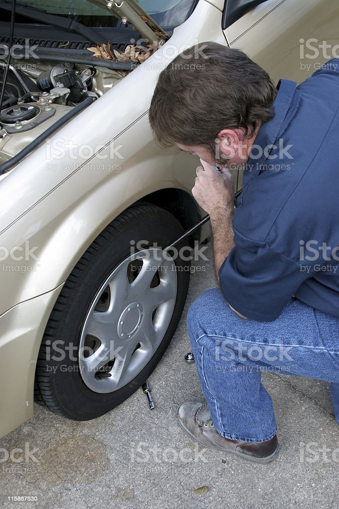 Removing Hubcap royalty-free stock photo