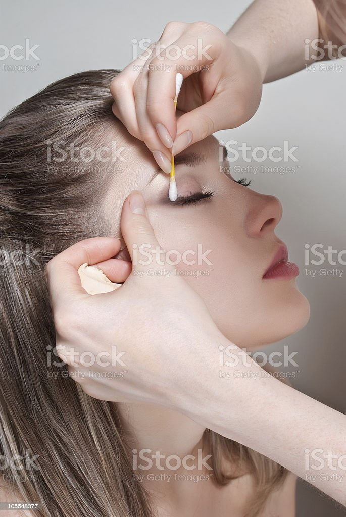 Removing makeup from face royalty-free stock photo