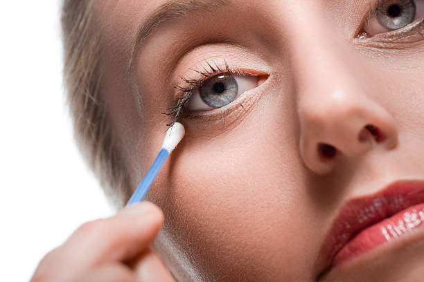 Removing make-up with cotton bud stock photo