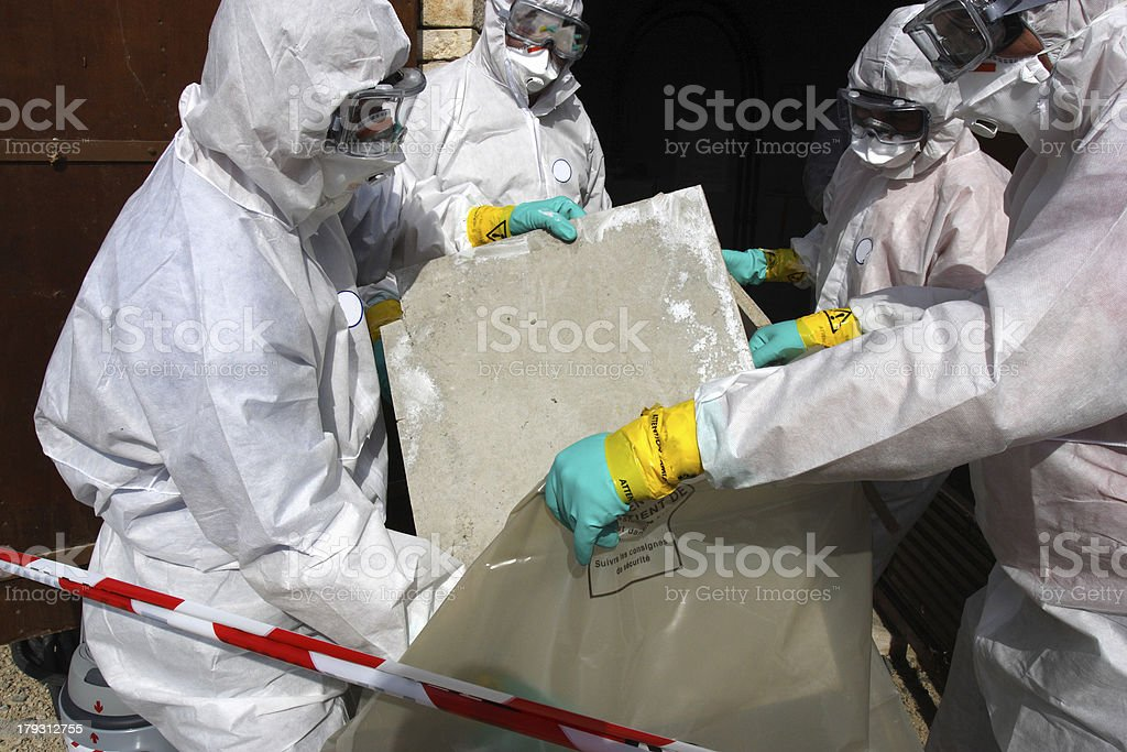 Removing materials containing some asbestos stock photo