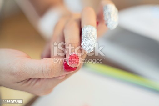 Removing nail polish from hand fingers with foil, beauty nail work tools