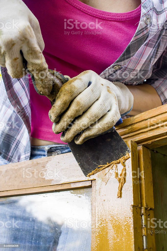 removing paint from old furniture stock photo