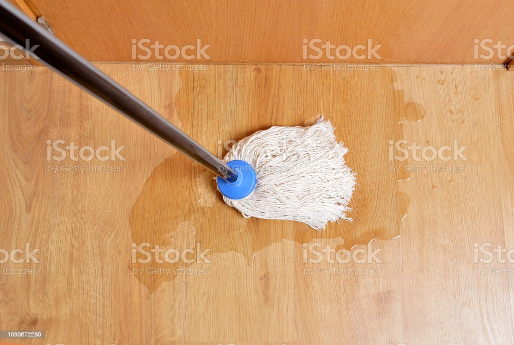 Removing Water From The Parquet Floor Stock Photo Download Image