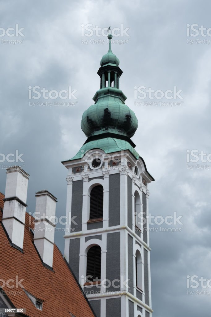 Renaissance belfry tower with cupola topped with a lantern of Kostel sv Josta (Church of St Jost) in Cesky Krumlov, Czech Republic. 16th century bell tower of Church of St Jost. stock photo