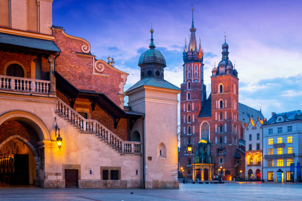 Renaissance Cloth Hall Sukiennice and Church Assumption of the Blessed Virgin Mary on the Main Market Square, Krakow, Poland stock photo