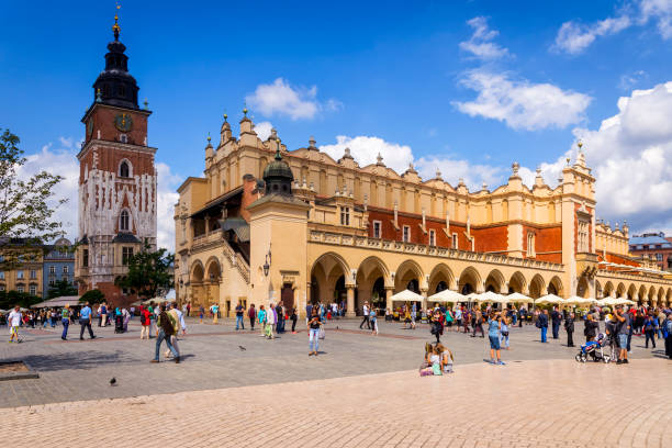 Renaissance Cloth Hall Sukiennice and Town Hall tower in the Main Market Square of Krakow, Poland stock photo