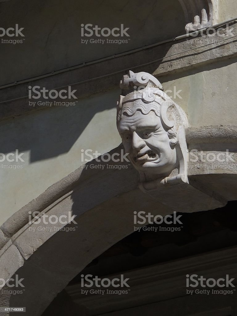 Renaissance facade, face with tongue out royalty-free stock photo