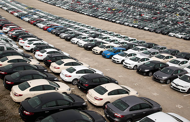 Renault Assembly Plant Bursa, Turkey - March 3, 2013: A wide range of vehicles from Renault wait for import/export to Europe at the Bursa Renault Plant. vehicle brand name stock pictures, royalty-free photos & images