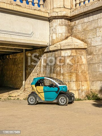 Valencia, Spain - October 26, 2020: Renault car model Twizy stationed in the Turia Garden. This small electric car is an excellent choice to move around this very long public park for maintenance purposes