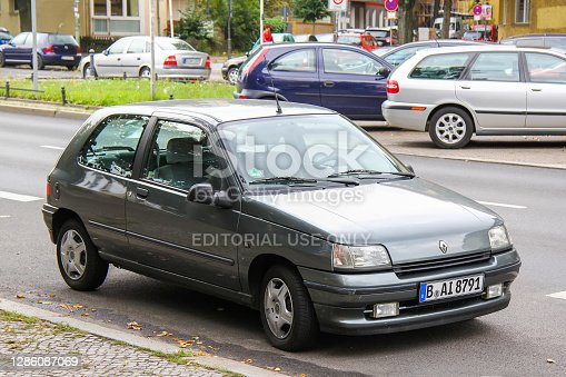Berlin, Germany - September 10, 2013: Grey compact car Renault Clio I in the city street.