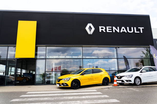 Renault company logo on car in front of dealership building Prague, Czech Republic - August 15, 2018: Renault company logo on car in front of dealership building on August 15, 2018 in Prague, Czech Republic. vehicle brand name stock pictures, royalty-free photos & images