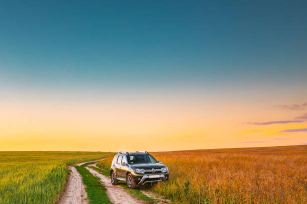 Renault Duster or Dacia Duster SUV in summer field countryside landscape. Duster produced jointly by French manufacturer Renault and its Romanian subsidiary Dacia stock photo