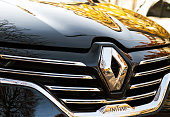 Renault Espace Initiale logo on chrome car