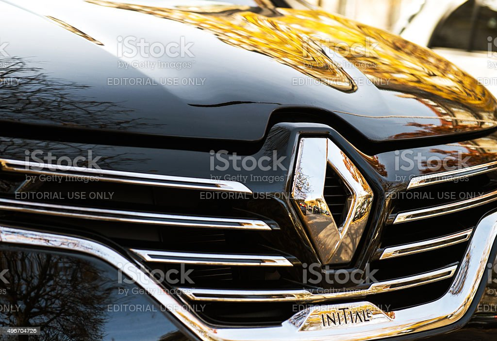 Renault Espace Initiale logo on chrome car stock photo