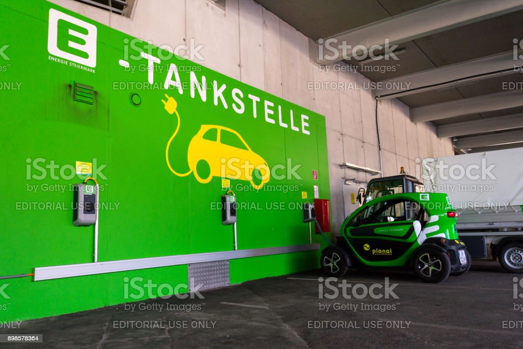 Renault Twizy electric city car stands at Energie Steiermark charching station on August 15, 2017 in Schladming, Austria. stock photo