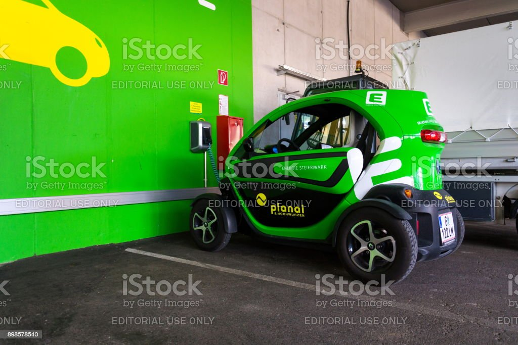 Renault Twizy electric city car stands at Energie Steiermark charching station in Schladming, Austria stock photo
