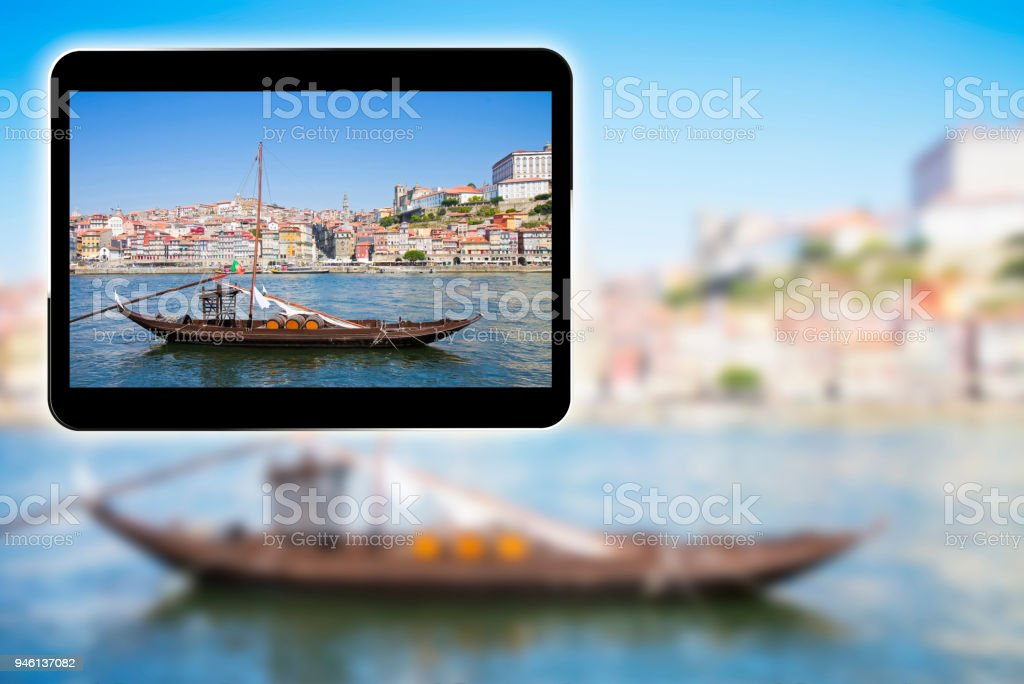 3D render concept image with a digital tablet showing a typical portuguese wooden boats, called Barcos Rabelos, used in the past to transport the famous port wine (Porto-Oporto-Portugal-Europe) stock photo