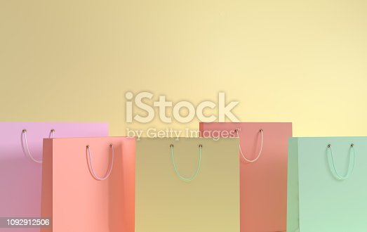 istock 3D render illustration. Set of pastel colored paper shopping bags on yellow background. Concept of commercial business retail sale and online shopping 1092912506