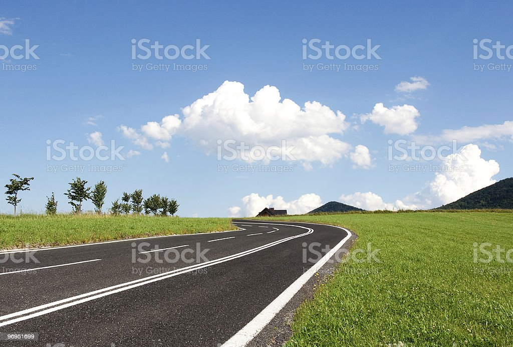 Rendered graphic of new road traversing a green field royalty-free stock photo