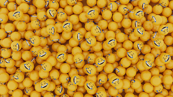 3d rendering of laughing tears emoji faces. large group pile of objects. yellow background.