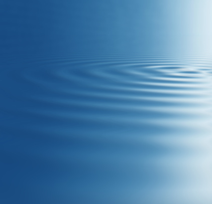 Wavy pattern made by ripples on blue water surface.