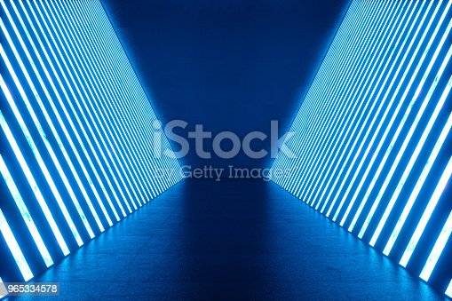 istock 3D rendering Abstract blue room interior with blue neon lamps. Futuristic architecture background. Mock-up for your design project. 965334578