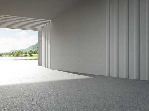 Abstract architecture design of modern building. Empty parking area floor and concrete wall with mountain and blue sky lake view.
