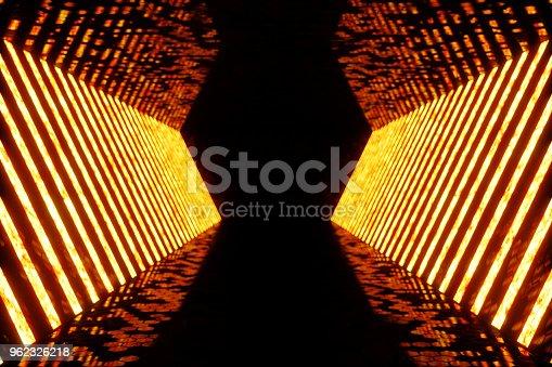 962326404istockphoto 3D rendering dark Illuminated corridor of red neon light. Elegant futuristic neon light on wall. 962326218