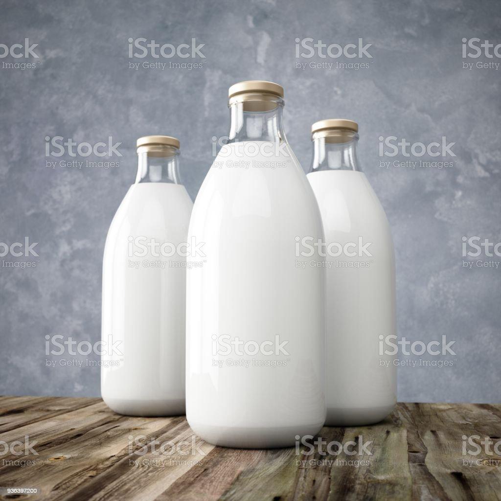3D rendering glass milk bottles on wooden table stock photo