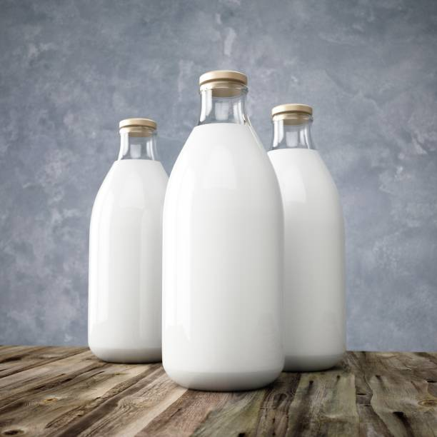 3d rendering glass milk bottles on wooden table - milk bottle stock photos and pictures