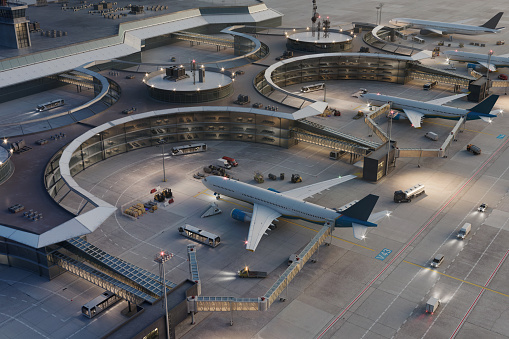 Aerial view of Airport with many airplanes at evening. 3D rendering of commercial aircrafts at airport terminal.