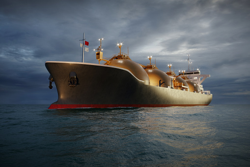 Computer generated image of oil and gas tanker sailing in ocean at night. 3d render of a LNG tanker carrier ship moving in sea.