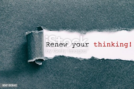 Renew your thinking written under torn paper.