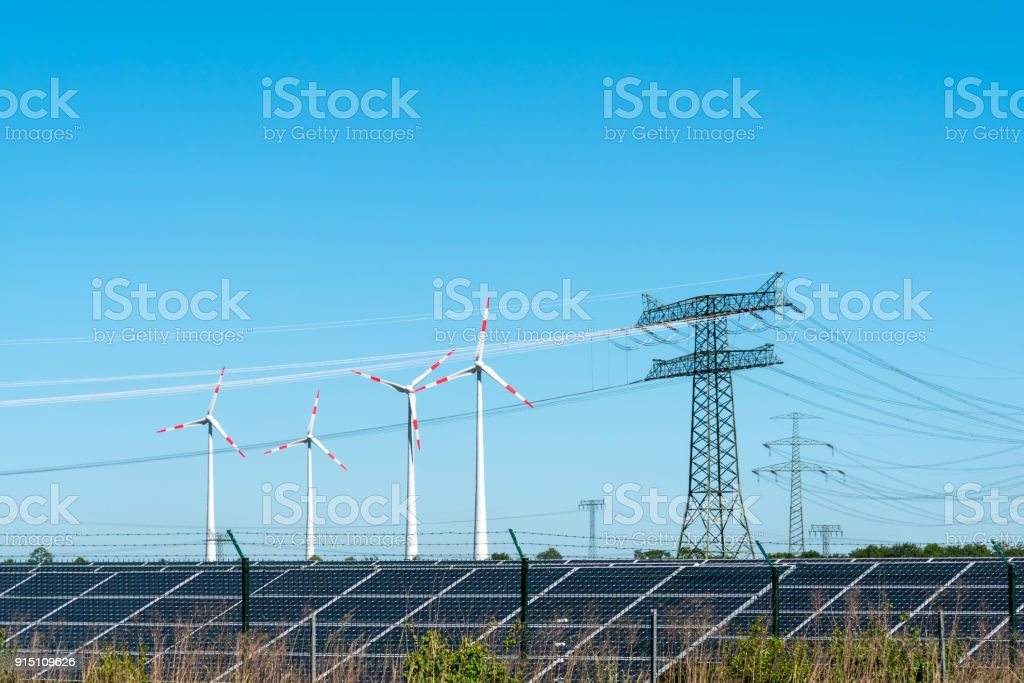 Renewable energy and transmission lines stock photo