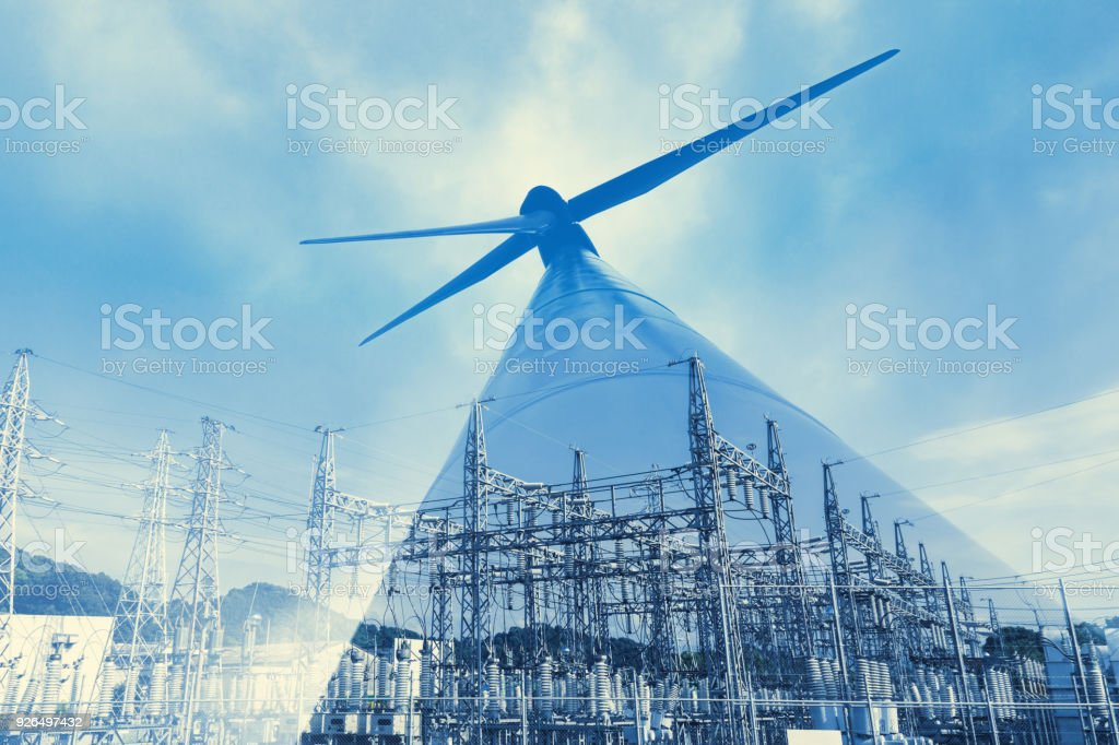 Renewable energy concept. Double exposure of Wind mill and substation. stock photo