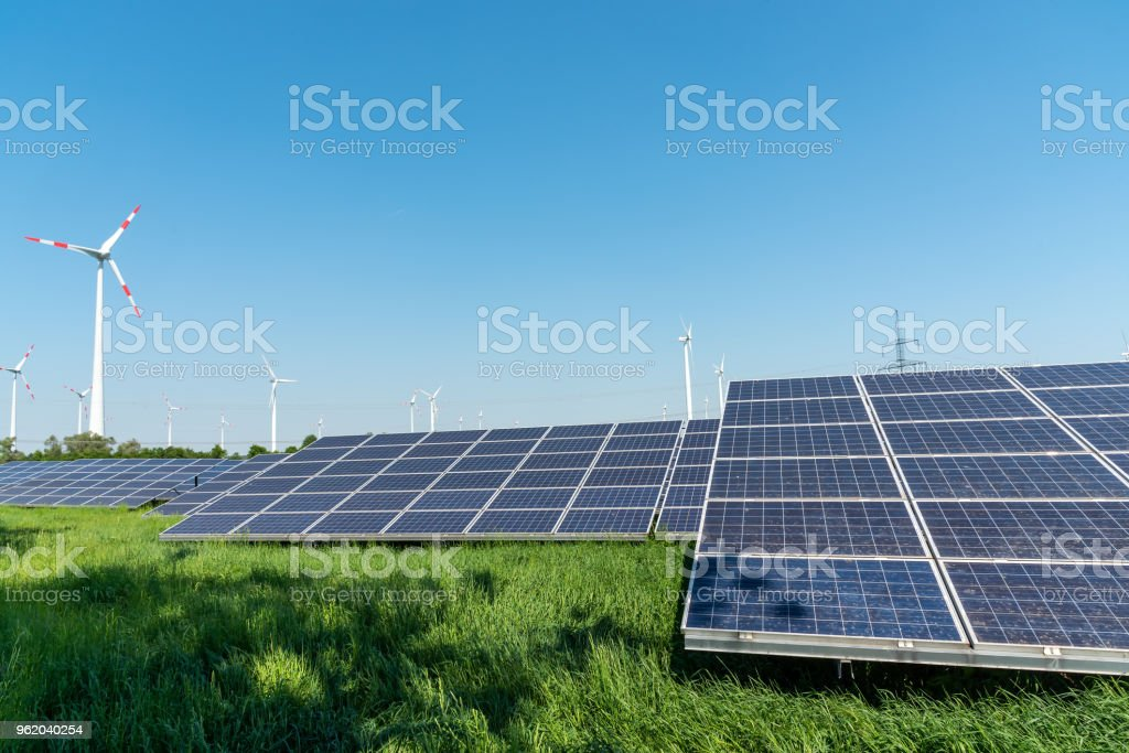 Renewable energy generation and power transmission lines stock photo