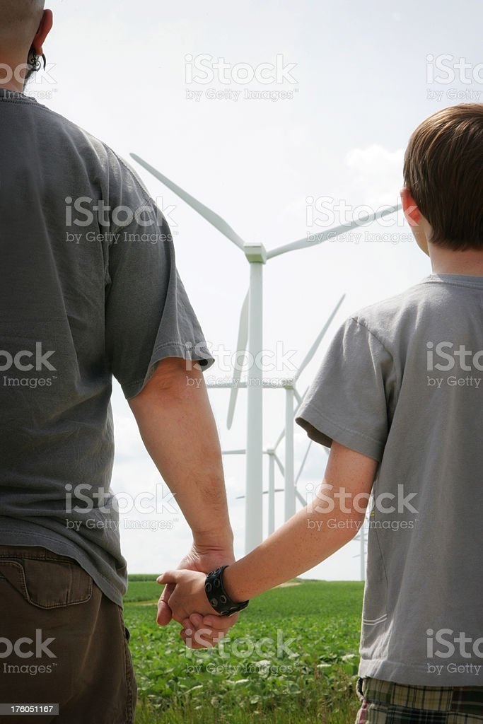 Renewable Energy Generations- Man and Child Look at Windmills royalty-free stock photo