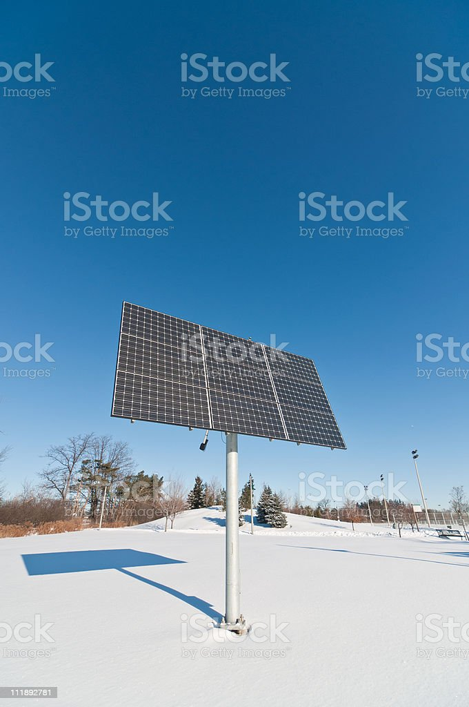 Renewable Energy - Photovoltaic Solar Panel Array in Winter royalty-free stock photo